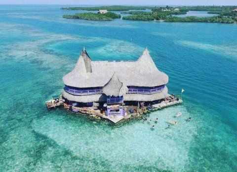 """This solo-powered hostel sits among the San Bernardo Islands, a few hours from the beautiful walled city of Cartagena, Colombia. Surrounded by nothing but calm tropical waters, Casa en el Agua (or """"House on the Water"""") is a secluded slice of island life that will have you hook, line and sinker. Not to mention the photos. Oh my, the photos."""