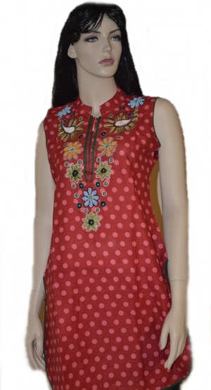 This is a red cotton kurti with floral embroidery work  embellished with colorful beads  over neck and white polka dots all over the body. This is perfect kurti to wear with Patiala pants.