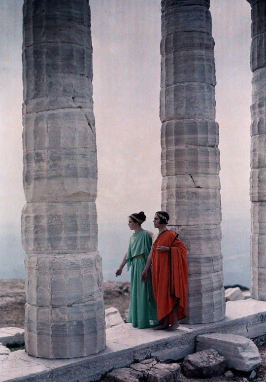 Two dancers in costume stand between the columns of Poseidon's Temple, Greece, 1930. Photograph by Maynard Owen Williams, National Geographic Creative