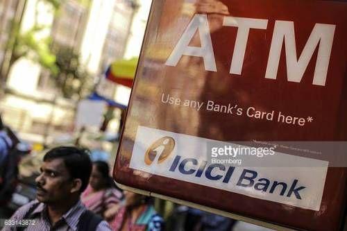 07-03 Pedestrians walks past signage for ICICI Bank Ltd.... #icici: 07-03 Pedestrians walks past signage for ICICI Bank Ltd.… #icici