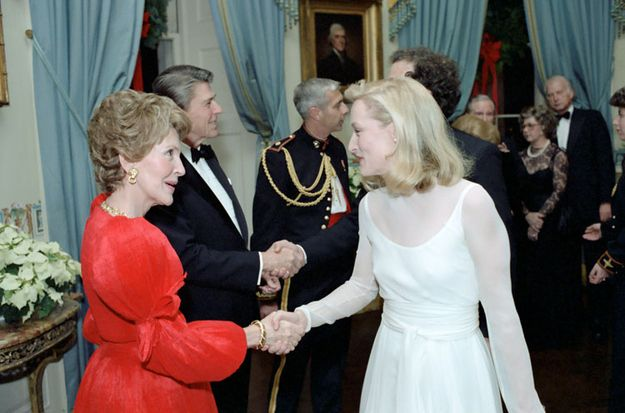 Nancy Reagan shaking hands with Meryl Streep.