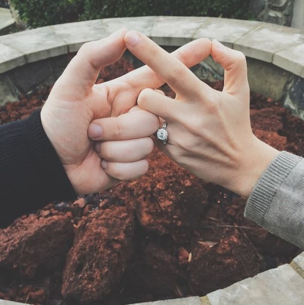 "For an extra symbol of forever, these two combined a ring photo with an infinity sign. Talk about the ultimate picture of eternity, this engagement announcement is easy to create and one of a kind.  | The Cutest ""Just Engaged"" Photos from Instagram"