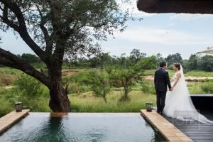 The only thing that could possibly top a rehearsal dinner in the middle of the South African wild, is a wedding following suit. This gem is overflowing with the raw beauty of an African safari couple...
