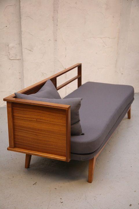 A vintage1950s daybed.  Polished teak frame. Sold by Cream & Chrome, UK