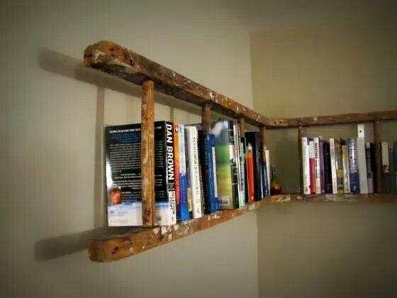 Re-purposed wooden ladder for bookshelves.  Genius !