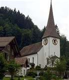 Fischenthal, Switzerland...We stayed in a small gasthof just down from this church,....this church rings it's bells every hour ON THE HOUR all night long !  :)  and the cows up on the mountainside all have large cow-bells on...which make noise.. all night long !  :)