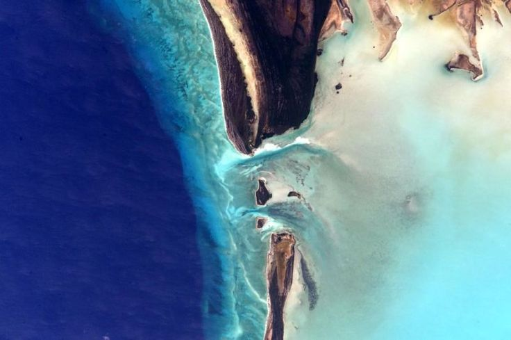 August 4, 2015: Concentrated waterflow carving the tip off an island. Image credit: NASA/Scott Kelly