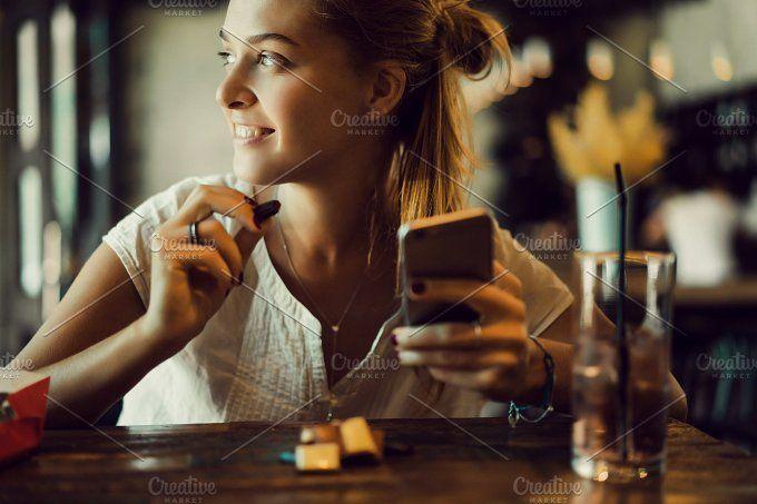 Beauty woman using smartphone by sergey.kozlov1815 on @creativemarket
