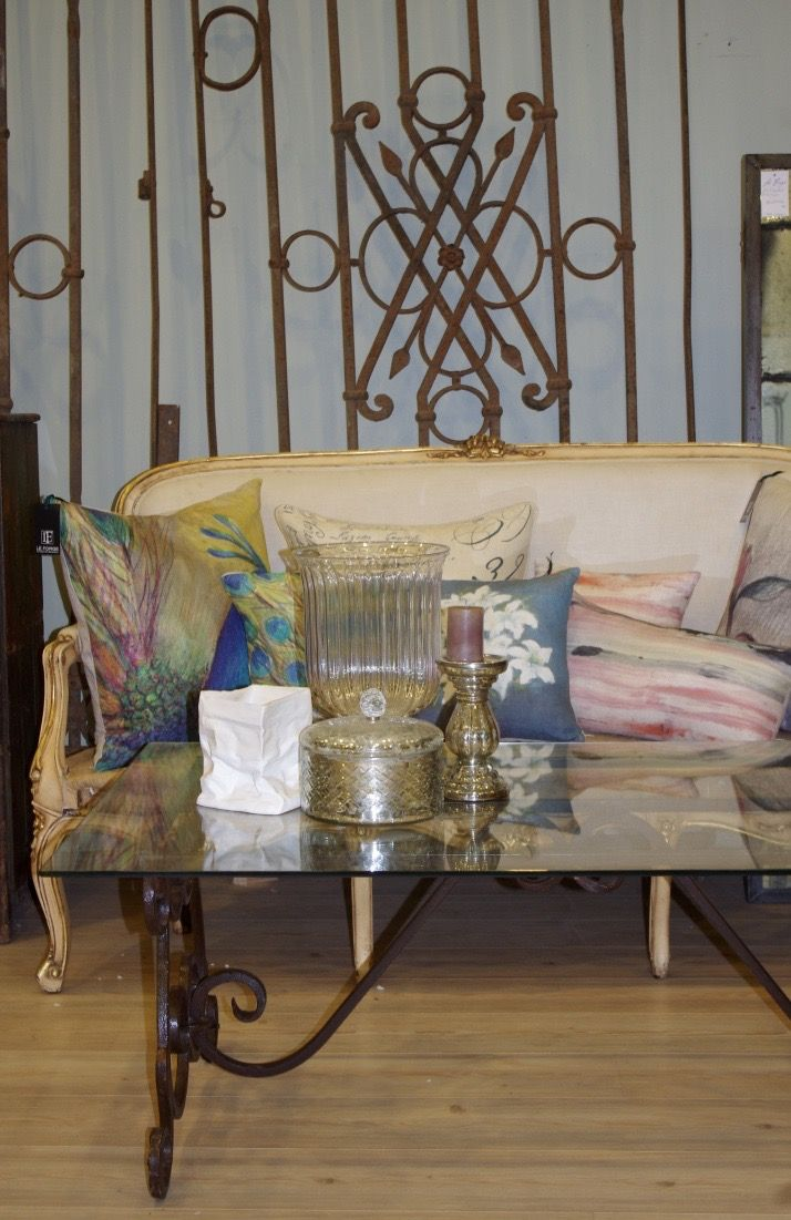 Vintage French sofa, vintage French gates, hand made Genevieve Levy cushions, hand forged Lutece coffee table. All from Le Forge Furniture And Decoration in Sydney Australia