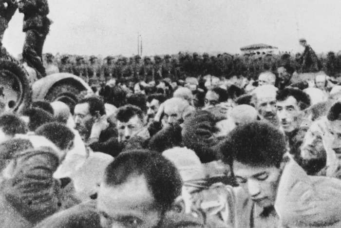Prisoners march to their death in the Majdanek concentration camp. To prevent further resistance, SS ordered the killing of surviving Jews in the Lublin District of German-occupied Poland.  Music was played through loudspeakers at both Majdanek and Trawniki to drown out the noise of the mass shootings. The killing at Majdanek 33,000, was the largest single-day, single-location massacre during the Holocaust.