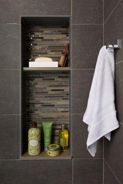 Dark tile shower shelves