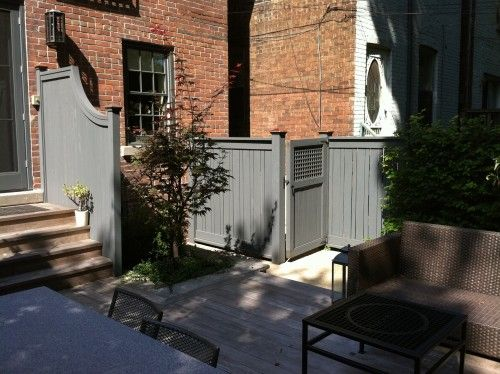 Use a gate as disguise. The panels that conceal the trash cans outside this home look like a classic fence-and-gate combo, thanks in part to the matching section that flanks the steps