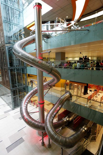 Shop and collect receipts to redeem for the big slide. The little slide is free.