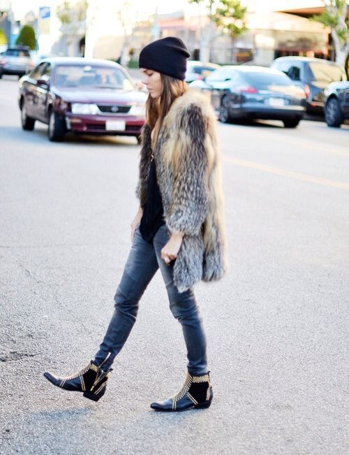 Winter fur coat, skinny jeans and short studded boots. Uber cool.