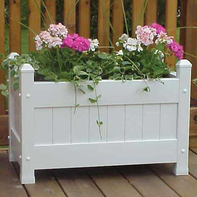 Dura-Trel The Dura-Trel Large Planter Box is the perfect accessory for adding the beauty of plants to your porch or patio. The paneled white sides are reminiscent of a picket fence for a charming plan