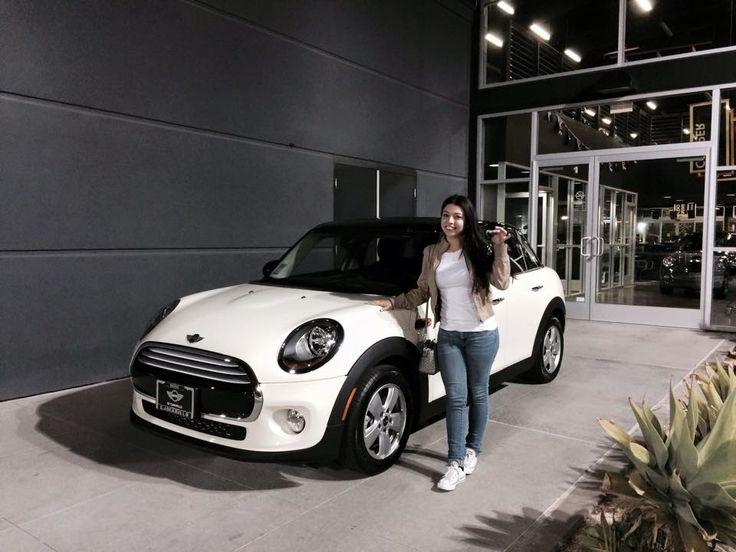 Ms. Mura is ready to make new adventures in her brand new 2015 MINI COOPER S 4 DOOR HARDTOP in Pepper White! Motoring Advisor Greg Lara.