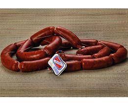 Chorizo 3ª Rosario. Embutido elaborado exclusivamente a partir de carne magra seleccionada de Cerdo Ibérico sin grasa añadida, condimentado con un aliño casero. Se vende por kilos en cajas de 4 ò 7 piezas de 750 Gr. aprox.