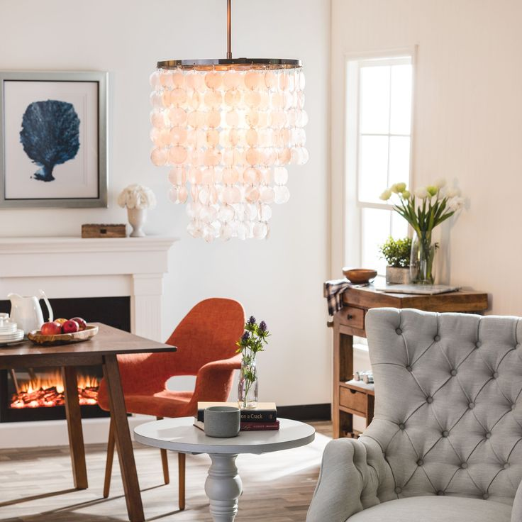 23 best capiz chandeliers images on pinterest light pendant capiz shell chandelier give your home a comfortable seaside appeal with this fun pendant the athena pendant features a brushed nickel finish frame and aloadofball Choice Image