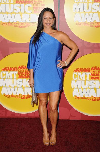 Sara Evans models a sexy, one-shoulder dress on the red carpet at the 2011 CMT Music Awards in Nashville on June 8, 2011. from Sara Evans