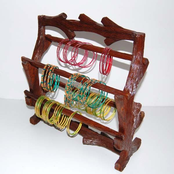A classy wooden bangle stand to cater to every women`s needs