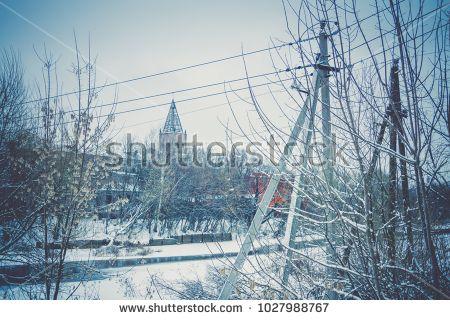Vintage style red brick old factory, filtered winter time landscape.