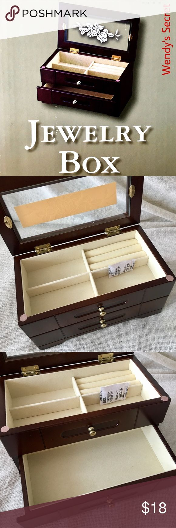 """🆕 Walnut Jewelry Box New in box Walnut Jewelry Box. An elegant jewelry box keeps your smallest treasures organized. Hinged top features a glass inset with an etched floral design. Felt lined interior equipped with 4 rectangular compartments for your earrings, pendants & rings. Goldtone pull opens a bottom drawer to provide a bigger space for your bracelets & brooches. Features: -Hinged lid -Glass top -1 drawer -4 divided compartments -3 rings rolls -Felt lining Dimensions: 9"""" W x 4 3/4"""" H x…"""