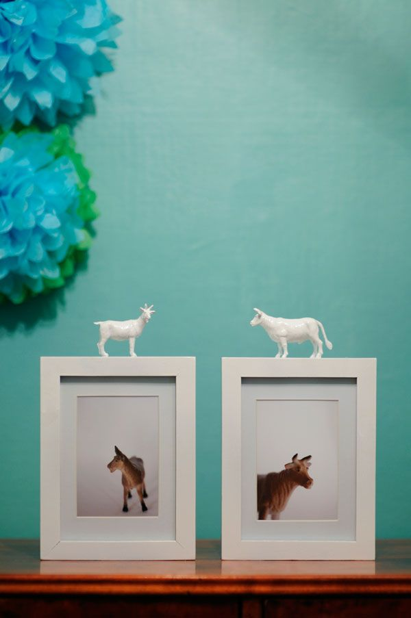 animal painted on frame- can redo this idea using small toys related to pictures.