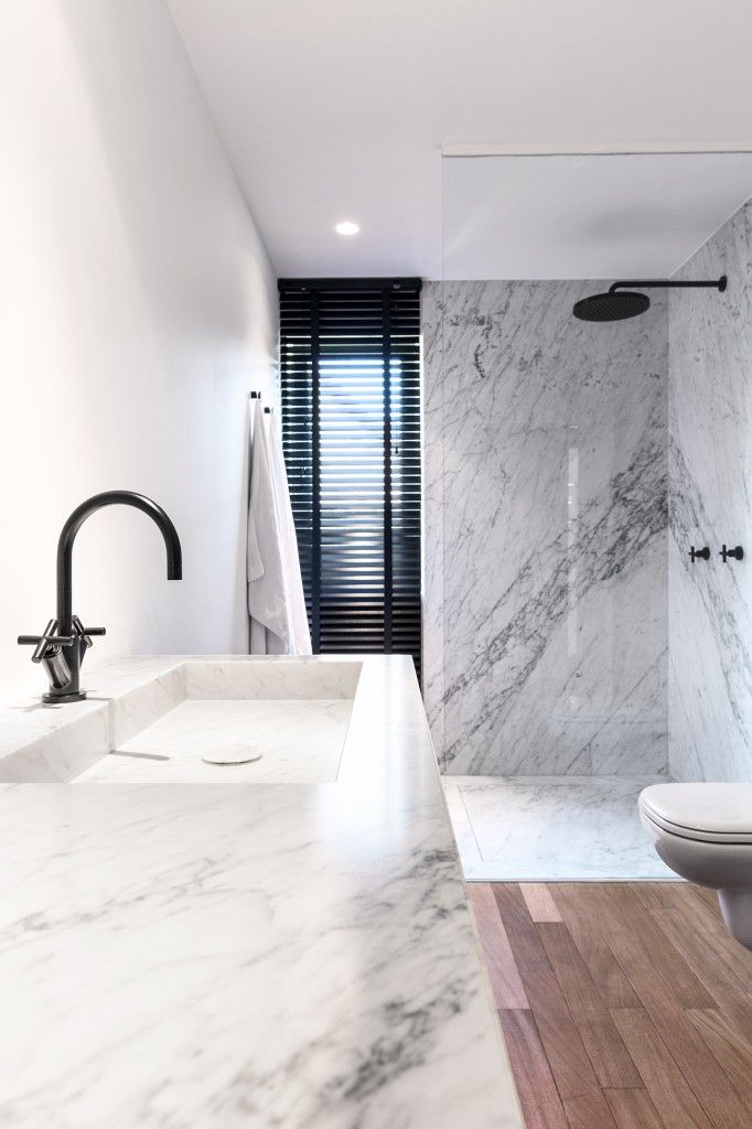 with marble and black fixtures Bathroom