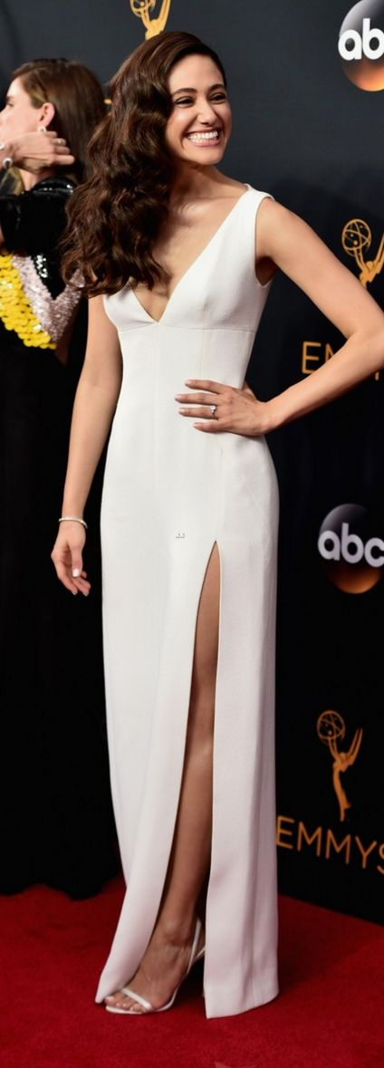 Emmy Rossum's white gown, sling back sandals, and brilliant smile