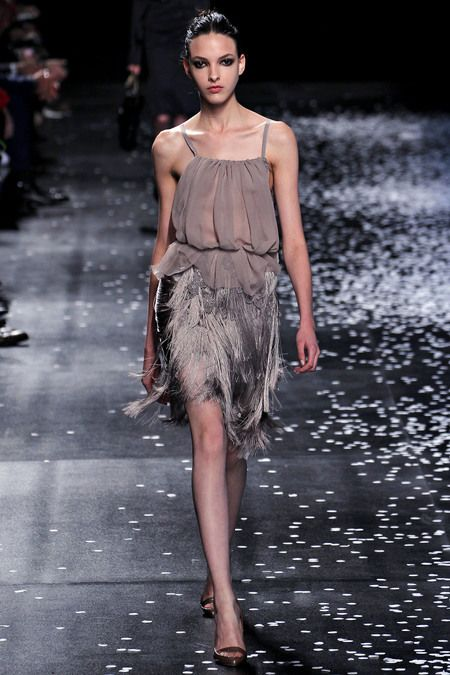 Nina Ricci. Spring 2013 Ready to Wear. Love the pairing of a light ruffled chiffon blouse against the textured fringed skirt.