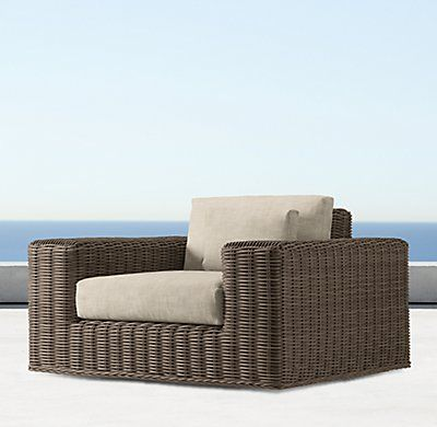 RH's Majorca Classic Swivel Lounge Chair:Inspired by the relaxed style of the Mediterranean, our Majorca collection offers generous proportions and modern lines. Woven by hand of all-weather wicker. Our Classic-size collections are perfectly proportioned for smaller spaces.
