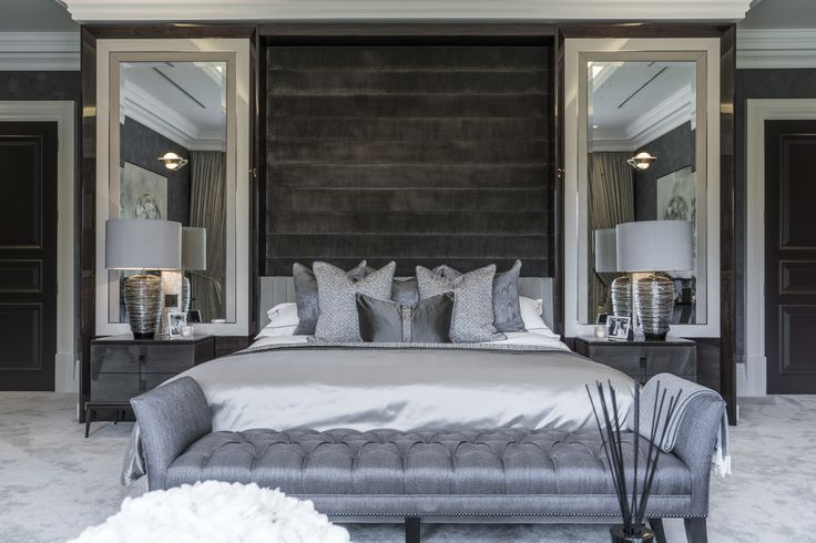 Utterly luxurious, we used an exquisite palette of greys in indulgent fabrics throughout our design of this master bedroom, completed by the end of bed stool in a Siracusa Slate weave by @designersguild.