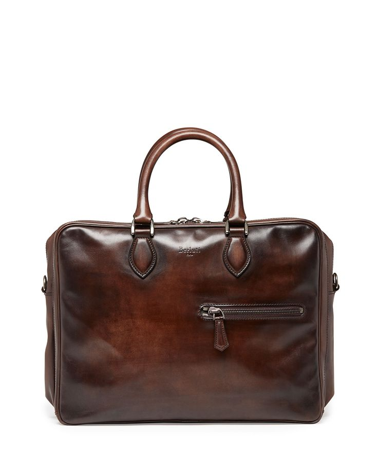 Berluti briefcase crafted in Venezia leather. Rolled top handles with rings. Three zip-fastened compartments. Front exterior zip pocket. Embossed Berluti logo detail. Made in Italy.