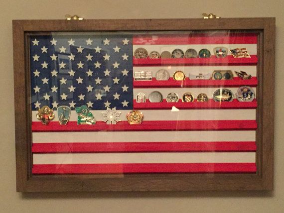 This is a hand-painted, all wood US Flag Coin Display. Each star is individually cut and painted. The overall dimensions are approximately 36 by 24, it is large enough enough to make quite a statement on your wall! This Challenge Coin Case is framed in antiqued oak, it has a piano hinge on the bottom and two sash latches up top for ease of opening and loading your coins. Easy to hang with flush mount hangars already installed. I make this one to order, takes about a week to get it done and…