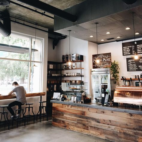 Coffee shop style. Wood, exposed brick, mixed metal accents