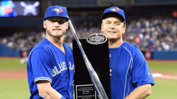 Toronto Blue Jays' Josh Donaldson, left, and manager John Gibbons pose with the Silver Slugger award given to Donaldson before AL baseball action in Toronto on Sunday, April 24, 2016. THE CANADIAN PRESS/Frank Gunn