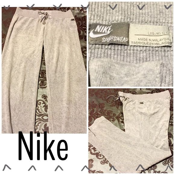 NIKE FUZZY VELOUR GRAY ATHLETIC PANTS Nike fuzzy gray athletic pants. These have a Nike silver & black little emblem attached on the side of the leg, & Nike on the bottom leg. Has an outer visible drawstring waist as well. Nike Pants Track Pants & Joggers