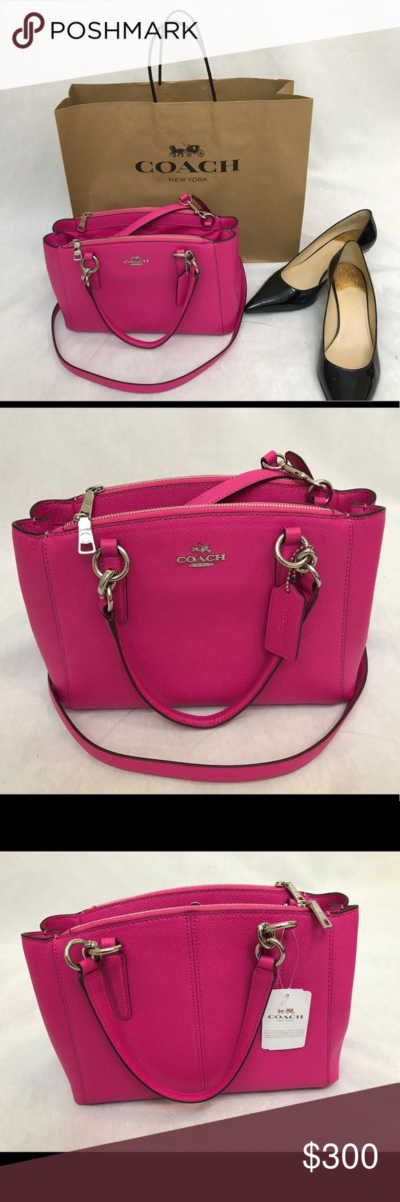 NWT Pink Coach Purse New with tags! Never worn beautiful pink purse with silver accents. Removable shoulder strap so handbag can be carried or worn over the shoulder. Includes care card to keep this handbag looking like new Coach Bags Shoulder Bags