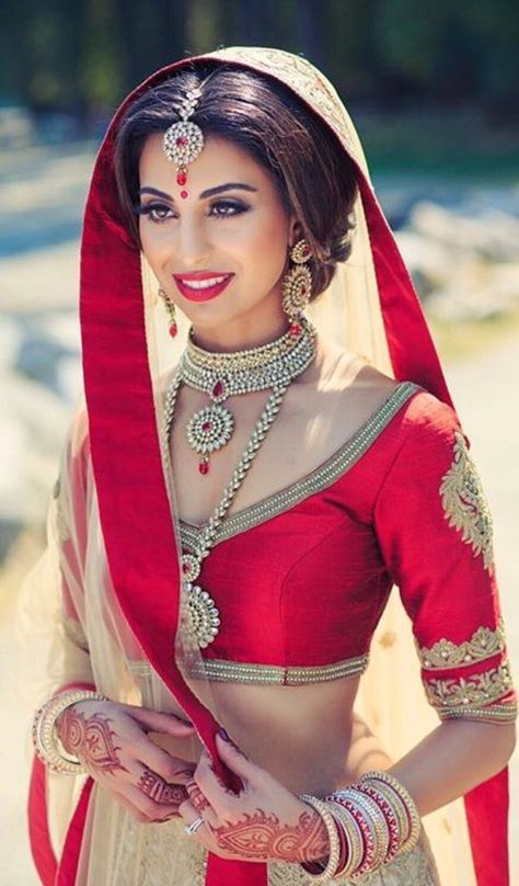 ooooh! pretty Indian bride! *Stunning* traditional red and gold  #IndianWedding | curated by Witty Vows - The ultimate guide for the Indian Bride | www.wittyvows.com