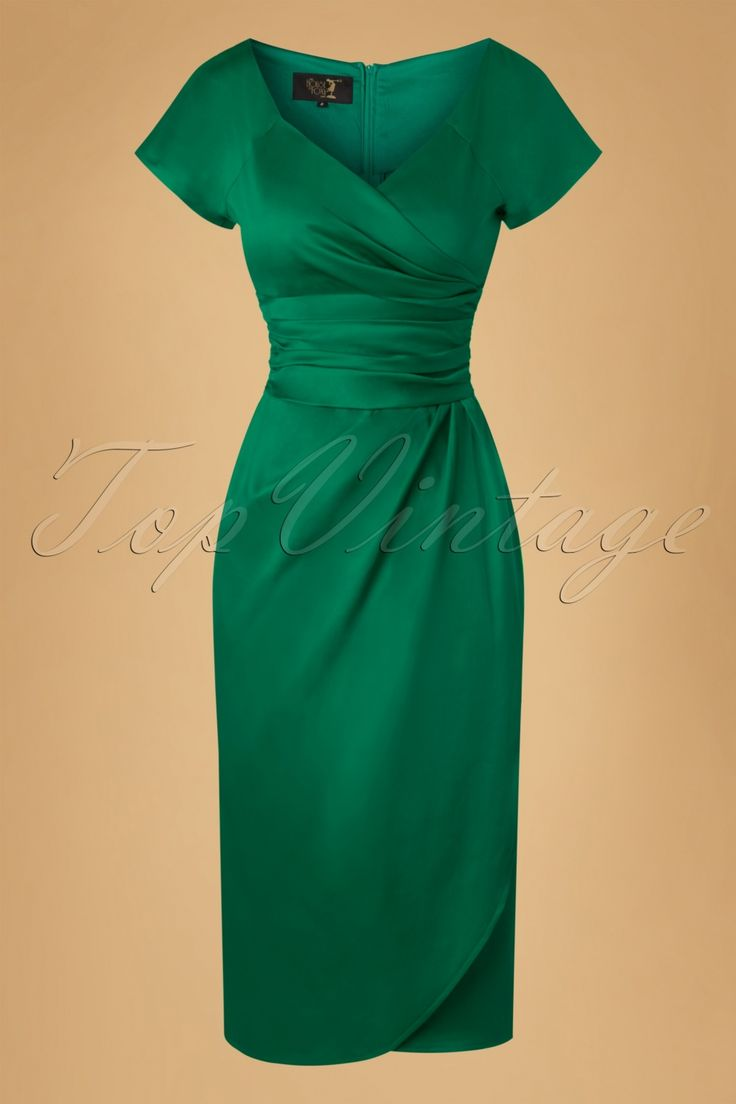 This 60s Dolce Vita Sarong Pencil Dress has just got it all!  This stunning pencil is inspired by the original early 60s cocktail dresses, the time when glamour really was at its height! The fitted bodice features elegant short sleeves, a classy wrap over neckline, a flattering ruched cummerbund and a draped sarong style skirt, só Mad Men. Made from an emerald green cotton blend with a satin shine and a light stretch, that kisses your curves without marking any pr...