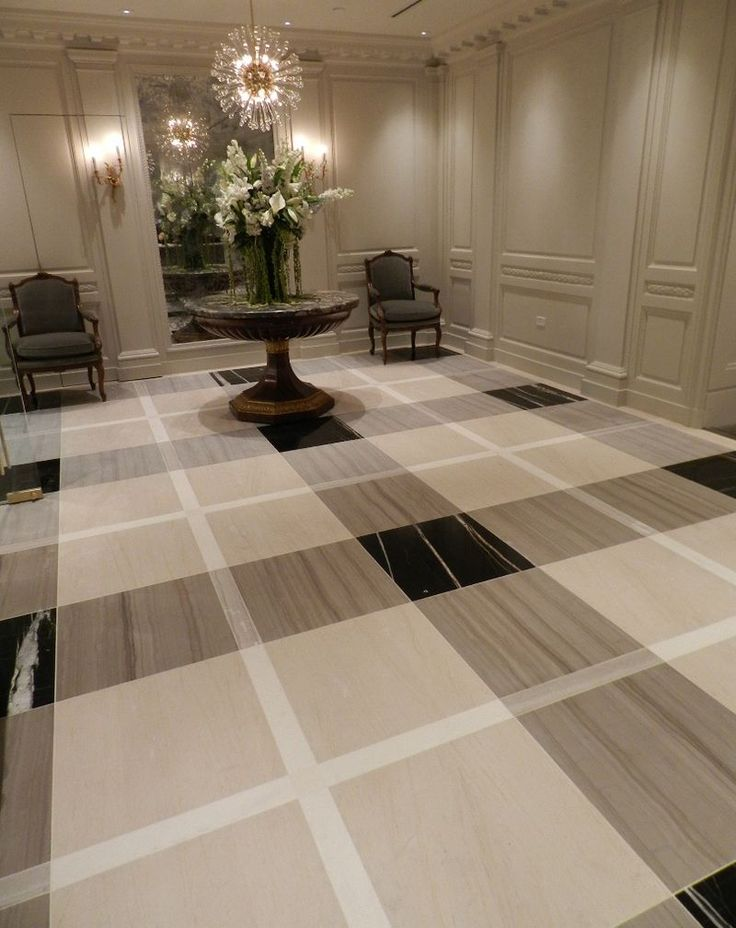 Charming Grey Trim With Lapis Door, Bold Checkered Floor Fils New York City Showroom.