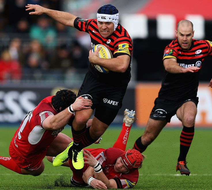 Saracens' Schalk Brits is caught by London Welsh defenders