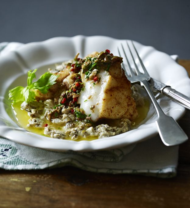 This is a very simple recipe with a piece of lightly spiced monkfish on a bed of aubergine purée served with a sharp, slightly spicy dressing