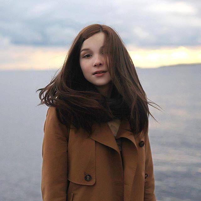 Katya Lischina in a brown coat