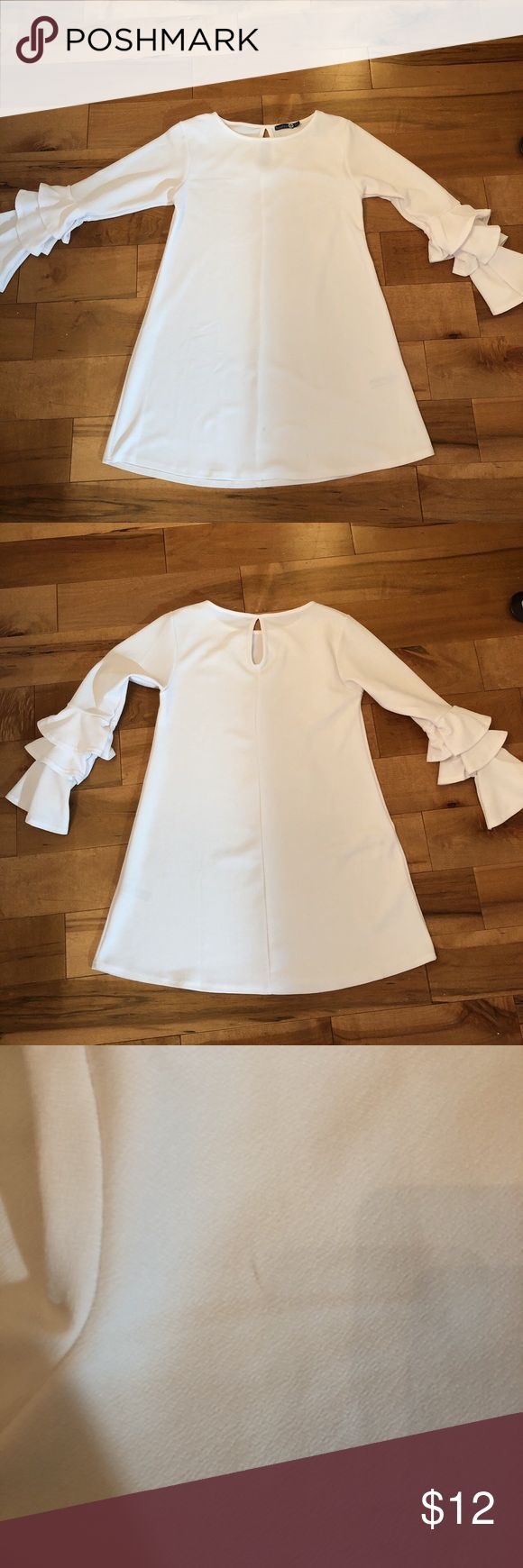 Boohoo plus white shift dress Size 12 US boohoo plus dress! White, shift, pretty ruffled sleeves. Very small stains that are barely noticeable and will probably come out with bleach. Worn once. Boohoo Plus Dresses Long Sleeve