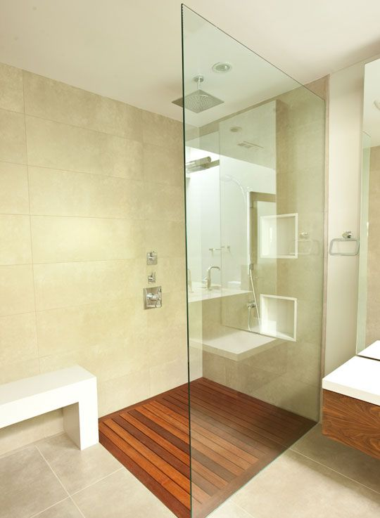 Oh yeah, that's a sweet shower w/ a teak floor. You can kinda see the rest of the bathroom in the reflection too. (Architect Branka Knezevic)
