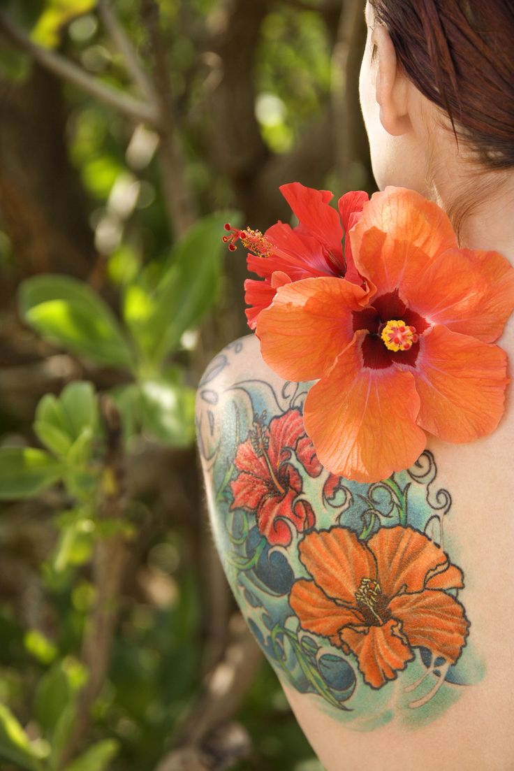Image from http://www.tattooneed.com/wp-content/uploads/2013/12/Hibiscus-flower-tattoo-for-women.jpg.