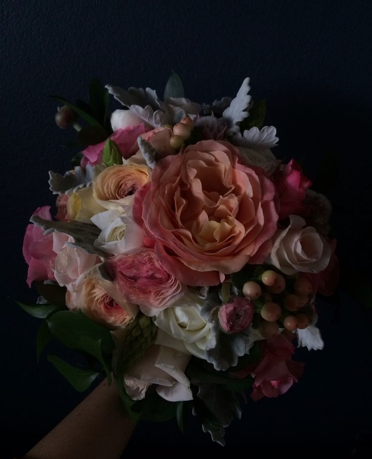 A soft bouquet full of fragrant roses, berries and ranunculus. { Briony + Cameron }