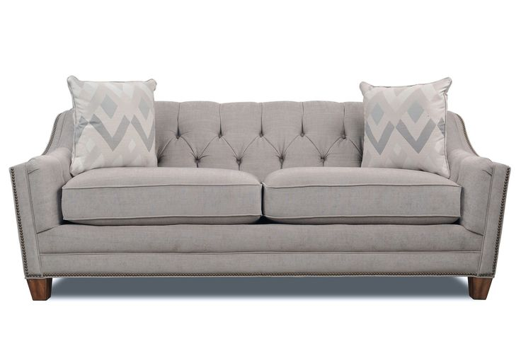 Living spaces furniture grey couch with studs home for Sofa with studs