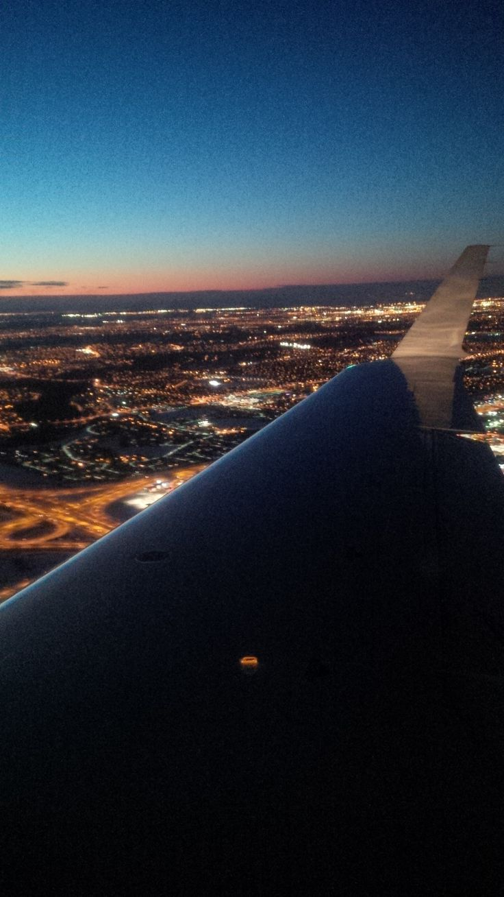 On a wing and a....... over edmonton at night.
